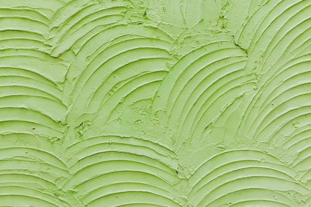 Zamyka w górę zielonej betonowej ściany tekstury
