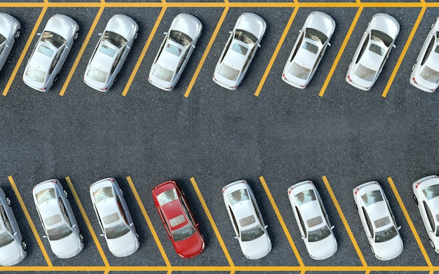 Zaparkowany czerwony samochód wśród białego samochodu. twój samochód na parkingu