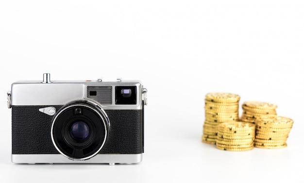 Zarabiać pieniądze od kamera fotografii pomysłu na białym tle