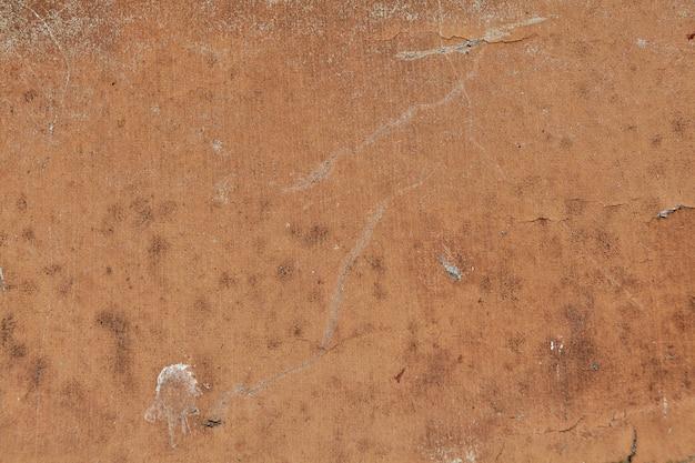 Zardzewiała blacha z wyblakłą teksturą farby na tle
