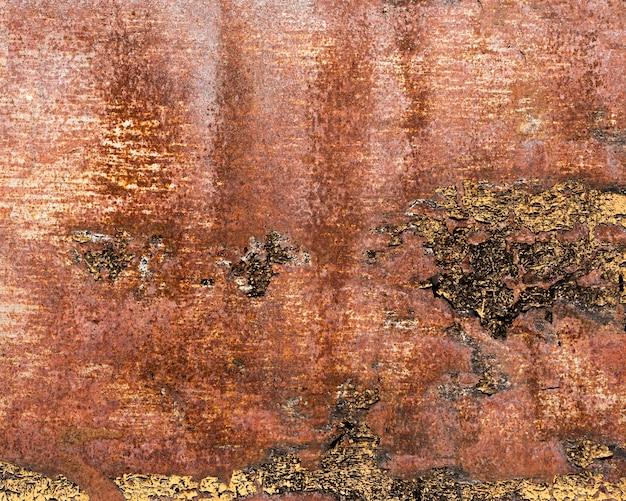 Zardzewiała i porysowana brązowa stalowa tekstura