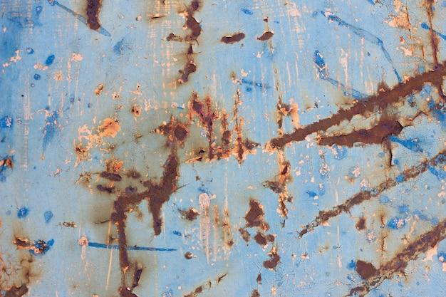 Zardzewiałe kolorowe metalowe tekstury. stara żelazna powierzchnia jest zużyta. pęknięta farba