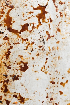Zardzewiały poplamiony brązowy tekstura ściana