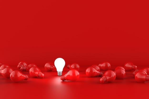 Żarówki na czerwonym tle. koncepcja pomysłu.