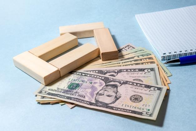Zbliżenie banknotów stanów zjednoczonych. oszczędzaj pomysły finansowe na dom
