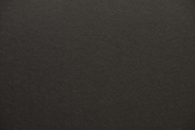 Zbliżenie bezszwowej czarnej tekstury papieru dla tła lub dzieł sztuki