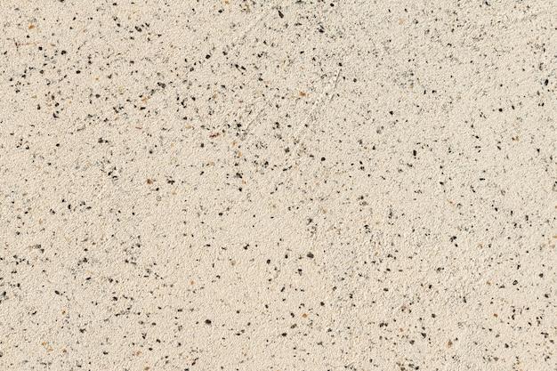 Zbliżenie bezszwowych tekstur jasnych marmurowych płytek granitowych z ciemnymi impregnacjami, powierzchnia projektu