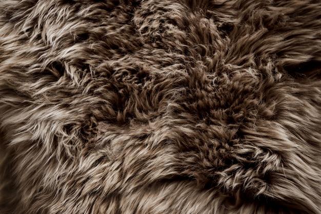 Zbliżenie brown futerkowa tekstura. gładkie puszyste i miękkie tło