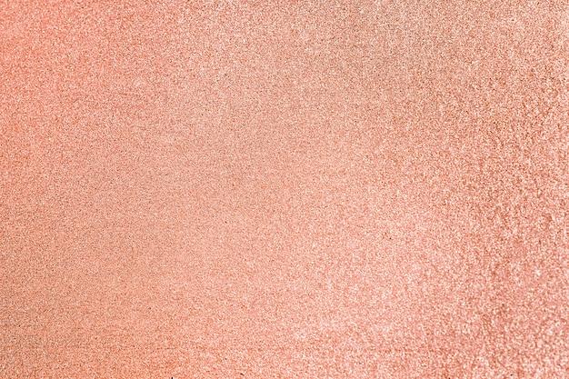 Zbliżenie brzoskwiniowego brokatu teksturowanego tła