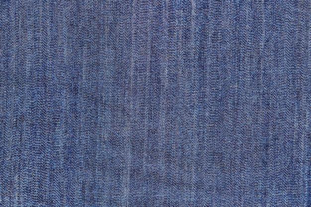Zbliżenie: ciemnoniebieskie dżinsy denim tło.