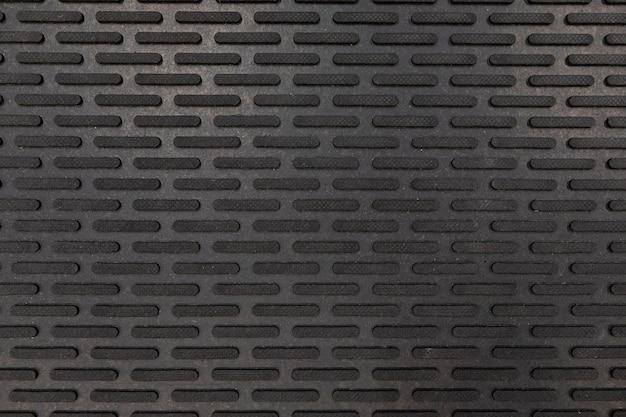 Zbliżenie czarnej gumowej maty podłogowej