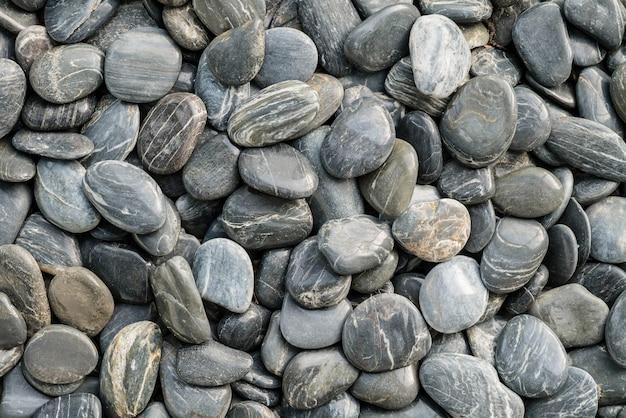 Zbliżenie czerni kamienia piękna podłoga dla dekoraci w ogrodowym textured tle