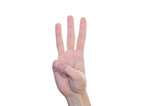 Zbliżenie dłoni pięknej pani sprawiają, że daje trzy palce na białym tle na białej ścianie copyspace