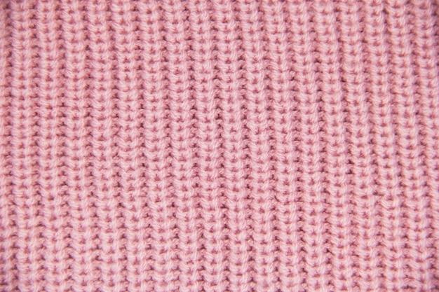 Zbliżenie dzianiny kolorowe zbliżenie wełny z dzianiny różowe tło
