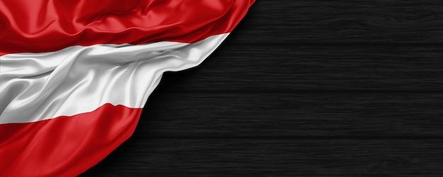 Zbliżenie flagi stanów zjednoczonych austrii na czarnym drewnianym tle renderowania 3d
