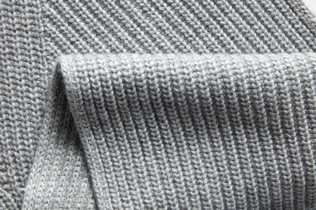 Zbliżenie makro tekstury dzianiny bawełnianej tkaniny wafel, odzież tło ze zmarszczkami i fałdami