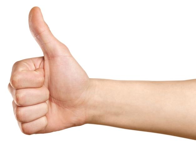Zbliżenie męskiej dłoni pokazując kciuk do góry znak na białym tle