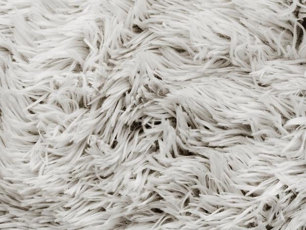 Zbliżenie: miękki biały dywan tło