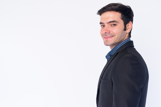 Zbliżenie młody przystojny biznesmen perski w kolorze na białym tle