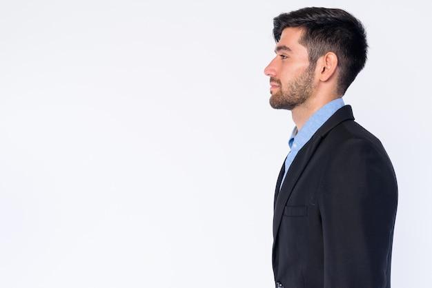 Zbliżenie młody przystojny brodaty biznesmen perski w kolorze na białym tle