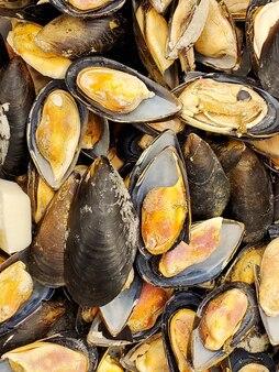 Zbliżenie mrożone małże. tekstura żywności. owoce morza
