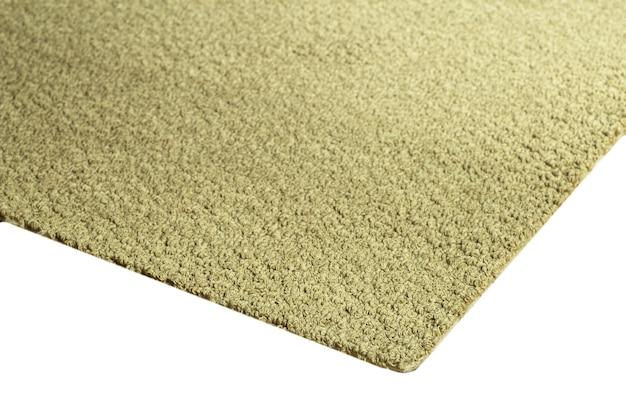 Zbliżenie na beżowym dywaniku tekstury na białym tle