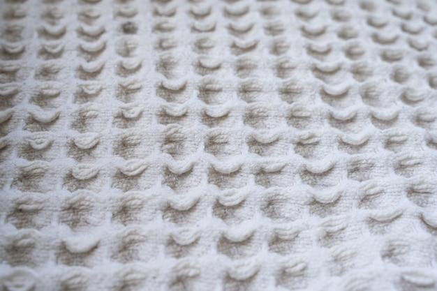 Zbliżenie na biały koc z wełny z kwadratami moda włókienniczych tekstury wzór koncepcje