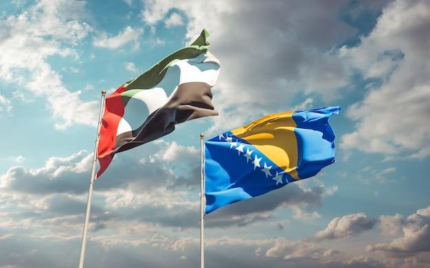 Zbliżenie na flagi emiratów arabskich zea oraz bośni i hercegowiny