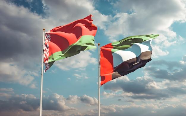 Zbliżenie na flagi zjednoczonych emiratów arabskich i białorusi