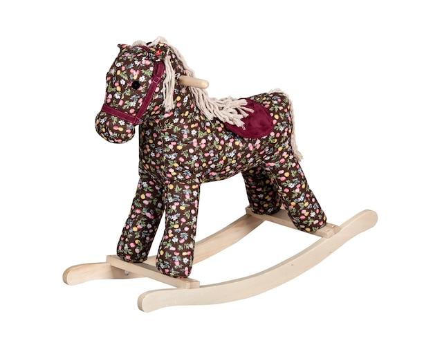 Zbliżenie na koń na biegunach zabawka dla dzieci na białym tle
