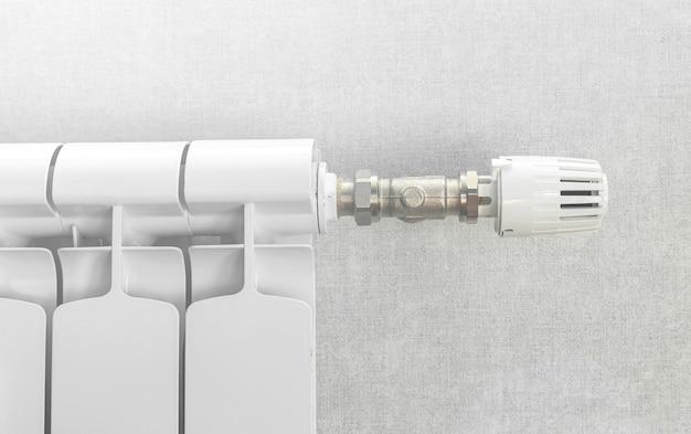 Zbliżenie na regulator zaworu termostatu grzejnikowego na tle białej ściany