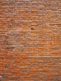 Zbliżenie na stary tekstura ściana z czerwonej cegły