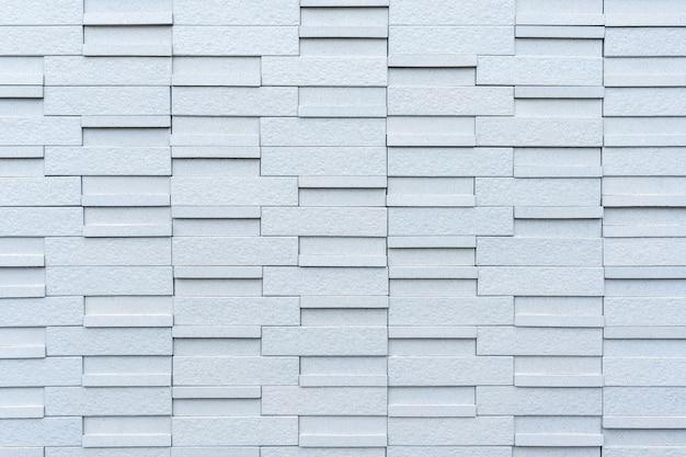 Zbliżenie na szarym tle ściany z cegły