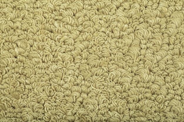 Zbliżenie na tapetę tekstury beżowy dywan