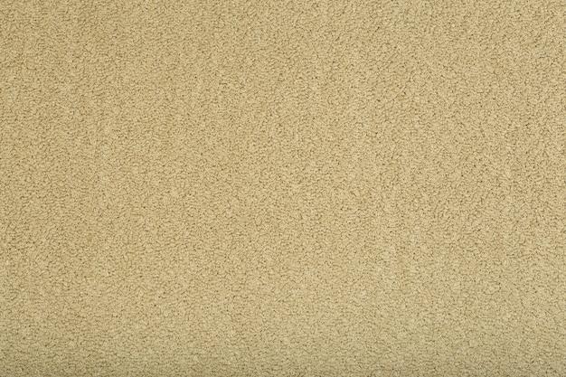 Zbliżenie na tapetę tekstury brązowy dywan