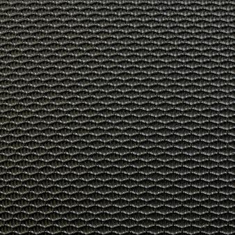 Zbliżenie nawierzchniowy stary czarny włókno przy bagaż tekstury tłem