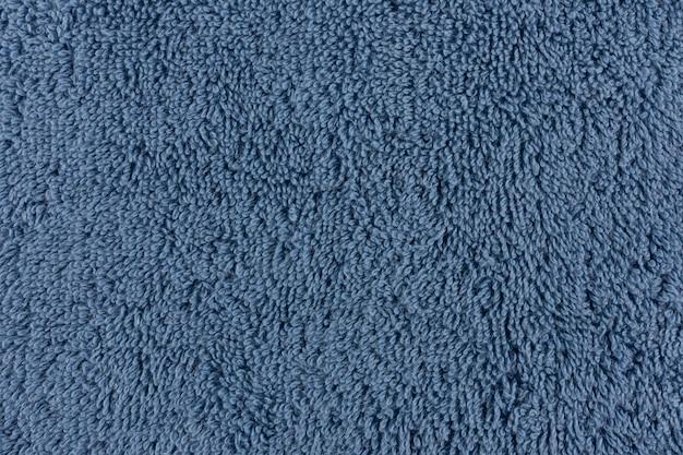 Zbliżenie niebieski ręcznik. tekstylne szczegóły tło.