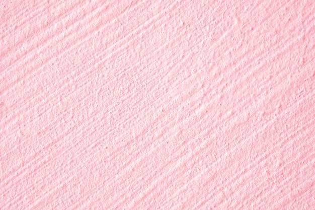 Zbliżenie patel szorstkiej różowej betonowej ściany zewnętrzny projekt dla tekstury i tła.