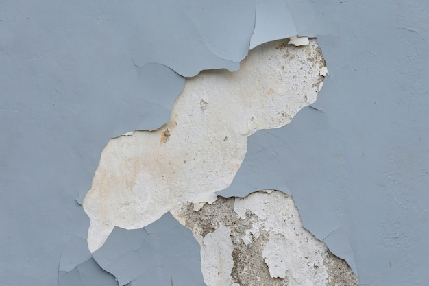 Zbliżenie pękniętej ściany tekstury na tle