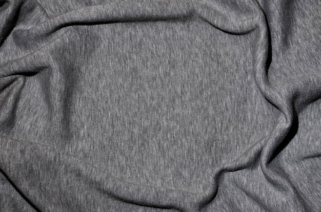 Zbliżenie pomiętego grzejnika i dzianiny sportowej koszulki lub bluzy z kapturem