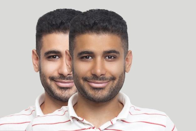 Zbliżenie portret młodej brunetki brodaty mężczyzna z innym odcieniem skóry twarzy, ciemniejszym i jaśniejszym, patrząc i uśmiechając się. przed i po, koncepcja opalania, leczenia i solarium. kryty strzał studio.