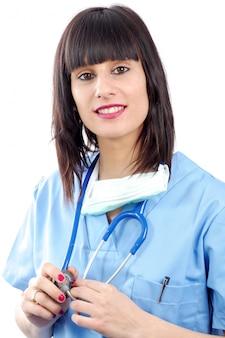 Zbliżenie portret młody żeński medyczny na bielu