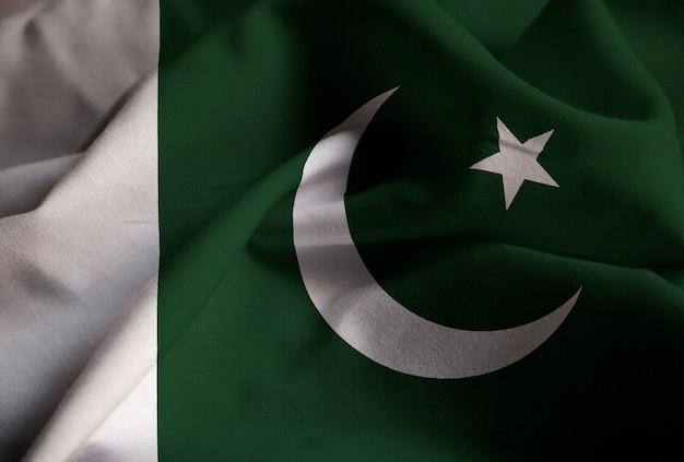 Zbliżenie potargane flaga pakistanu, flaga pakistanu wiejący wiatr