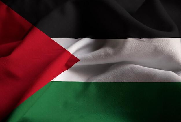 Zbliżenie potargane flaga palestyńska, flaga palestyńska wiejący wiatr
