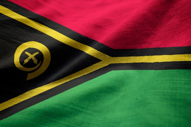 Zbliżenie potargane flagi vanuatu, flaga vanuatu wiejący wiatr