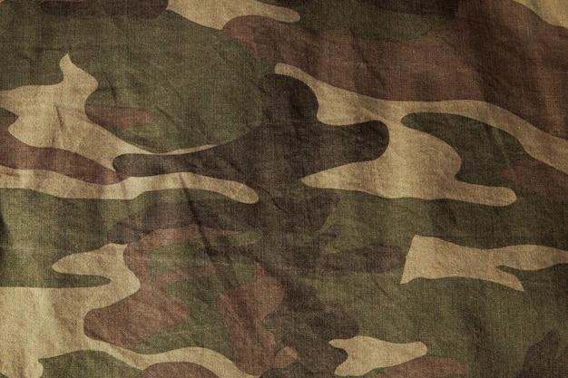 Zbliżenie powierzchni munduru wojskowego. tekstura tkaniny, zbliżenie, wojskowe zabarwienie