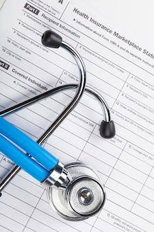 Zbliżenie stetoskop na medycznym tle