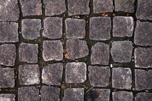 Zbliżenie szare kafelki tekstury chodnika na tle