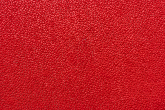 Zbliżenie, tekstura naturalnej czerwonej skóry na materiały tła i mebli