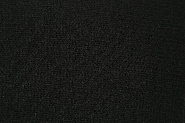 Zbliżenie tekstury czarnej dzianiny wełnianej